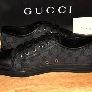 A pair of Gucci shoes
